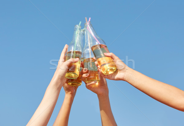 close up of many hands clinking bottles Stock photo © dolgachov