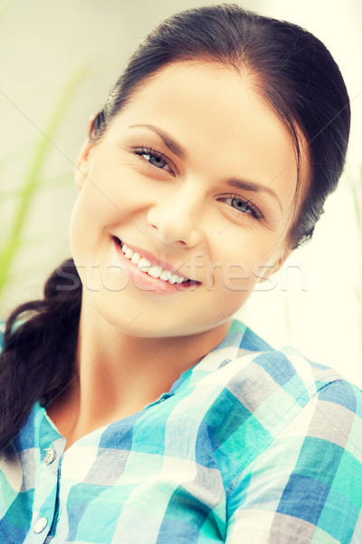picture of smiling woman at home Stock photo © dolgachov