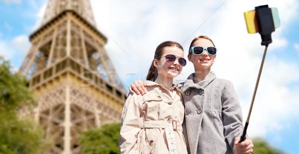 Kızlar sopa Eyfel Kulesi insanlar çocuklar Stok fotoğraf © dolgachov