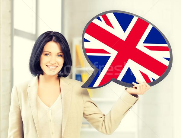 Gülümseyen kadın metin kabarcık İngiliz bayrağı eğitim yabancı Stok fotoğraf © dolgachov