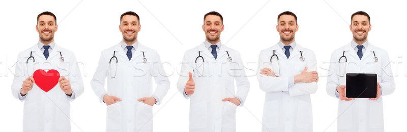 Orvosok piros szív táblagép vágólap gyógyszer Stock fotó © dolgachov