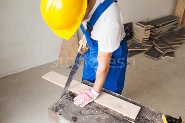Construtor braço serra conselho edifício Foto stock © dolgachov