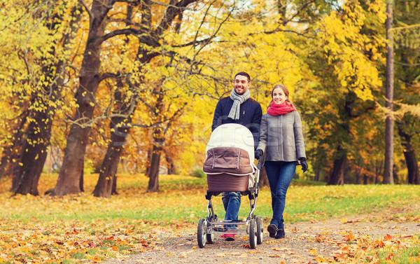 Mosolyog pár baba babakocsi ősz park Stock fotó © dolgachov