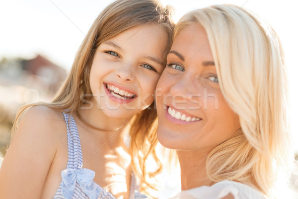happy mother and child girl outdoors Stock photo © dolgachov