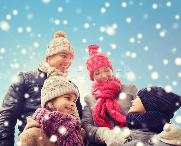 happy family in winter clothes outdoors Stock photo © dolgachov