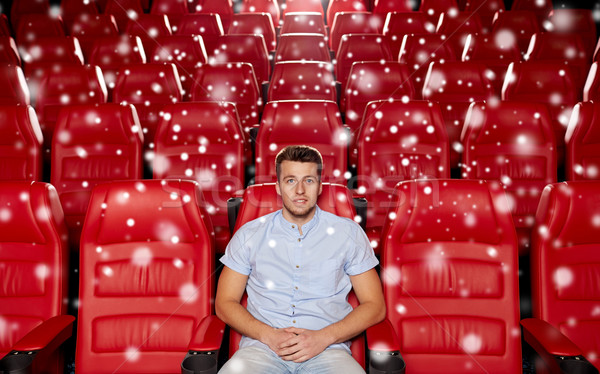 happy young man watching movie in theater Stock photo © dolgachov