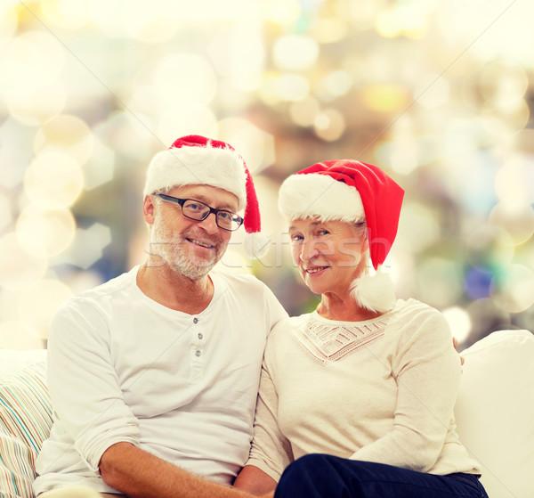 happy senior couple in santa helper hats Stock photo © dolgachov