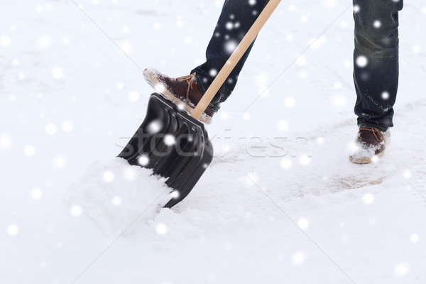closeup of man digging snow with shovel Stock photo © dolgachov