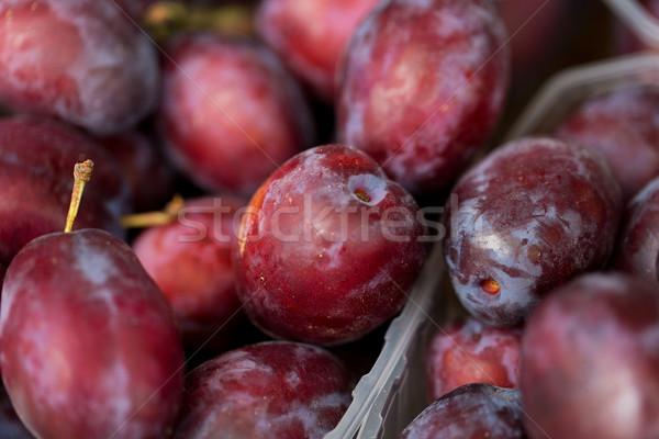 close up of satsuma plums in box at street market Stock photo © dolgachov