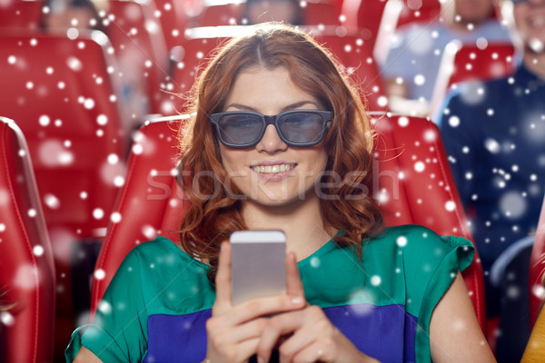 Felice donna smartphone 3D film teatro Foto d'archivio © dolgachov