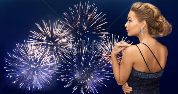 Nő gyémánt fülbevaló tűzijáték emberek ünnepek Stock fotó © dolgachov