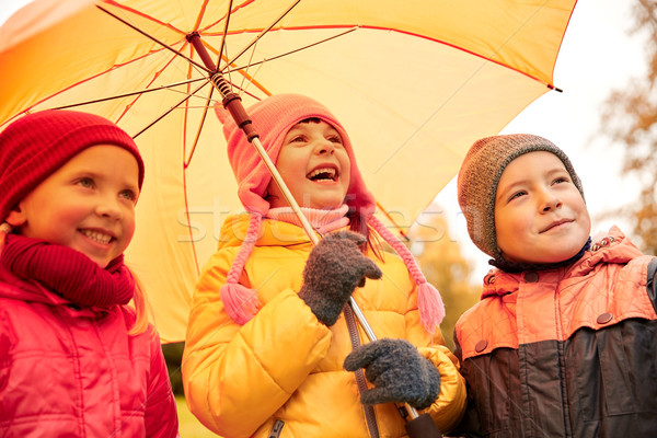 happy children with umbrella in autumn park Stock photo © dolgachov