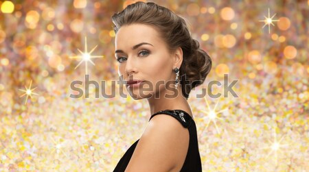 beautiful sexy woman in red dress over glitter Stock photo © dolgachov
