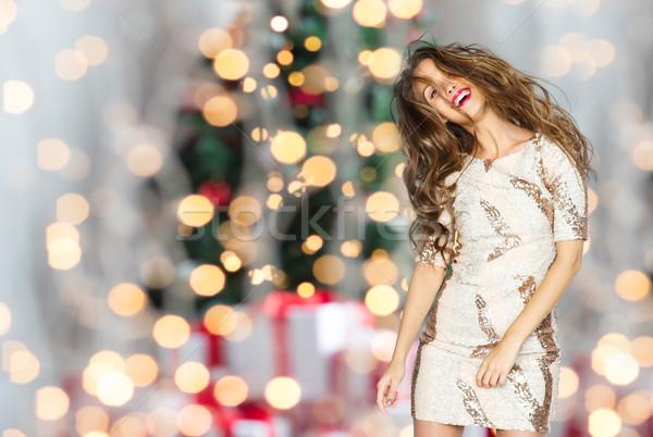 happy woman or teen dancing over christmas lights Stock photo © dolgachov