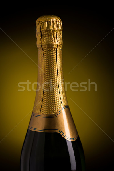 close up of champagne bottle with blank label Stock photo © dolgachov