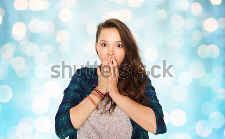confused teenage girl covering her mouth by hand Stock photo © dolgachov