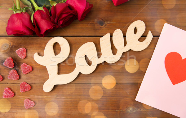 close up of gift box, red roses and greeting card Stock photo © dolgachov