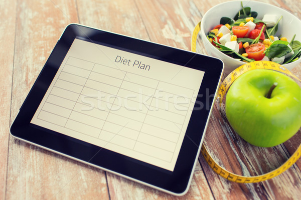 close up of diet plan on tablet pc and food Stock photo © dolgachov