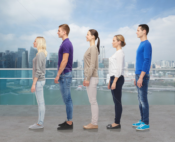 group of people over city waterside background Stock photo © dolgachov
