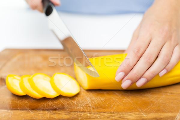 Mains squash couteau Photo stock © dolgachov
