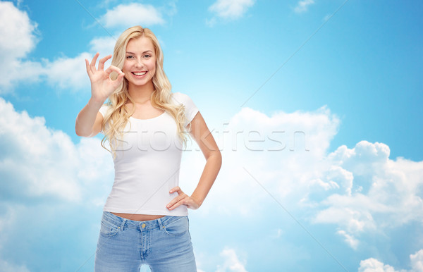 happy young woman in white t-shirt showing ok sign Stock photo © dolgachov