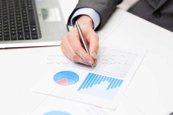 close up of businessman hand with charts in office Stock photo © dolgachov