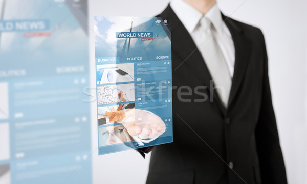 close up of man hand showing world news projection Stock photo © dolgachov