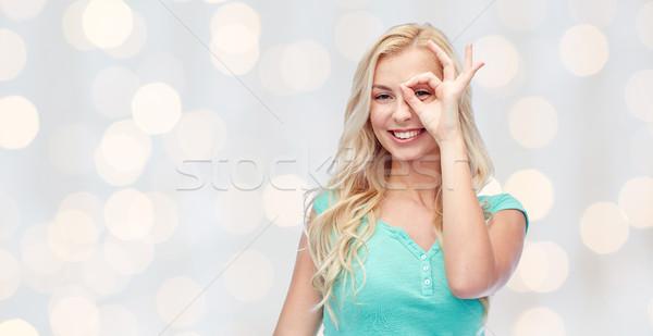 Fiatal nő készít ok kézmozdulat jókedv érzelmek Stock fotó © dolgachov