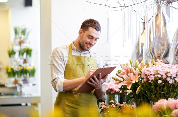 Virágárus férfi vágólap virágüzlet emberek vásár Stock fotó © dolgachov