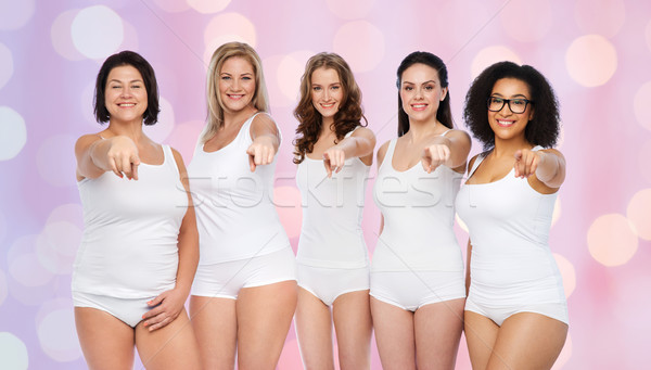 Stock photo: group of happy different women pointing on you