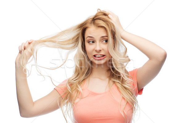 woman holding strand of her hair Stock photo © dolgachov