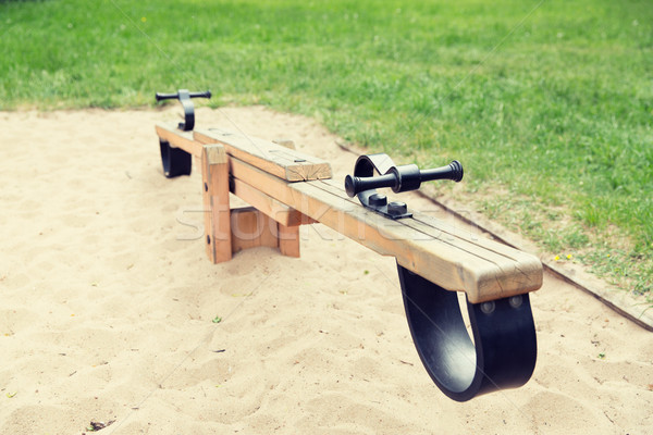 close up of swing or teeterboard on playground Stock photo © dolgachov