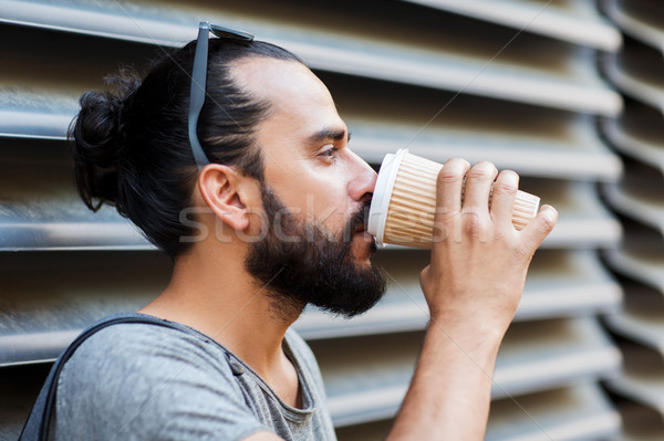 man drinking coffee from paper cup on street Stock photo © dolgachov