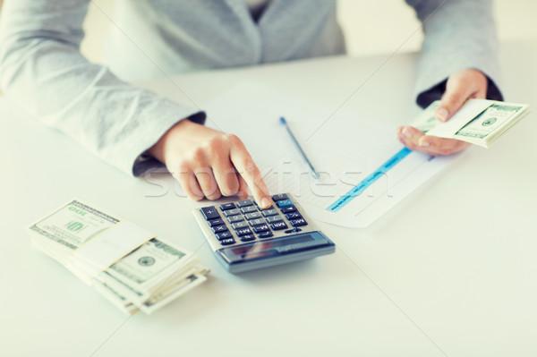 Közelkép kezek pénz számológép üzlet pénzügy Stock fotó © dolgachov