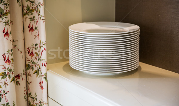close up of plates on cupboard shelf Stock photo © dolgachov