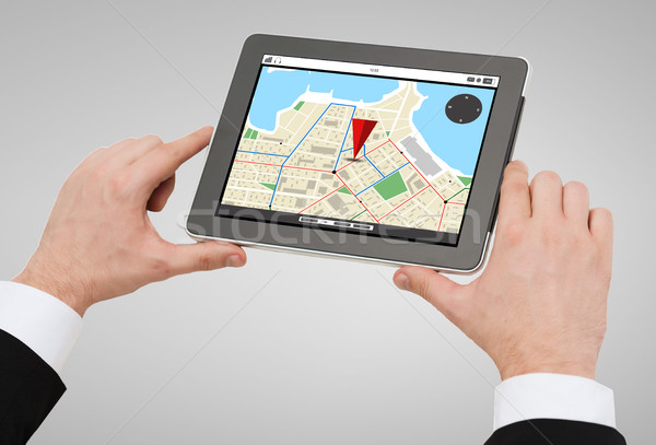 close up of man hands holding tablet pc Stock photo © dolgachov