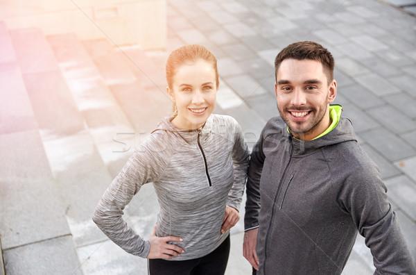 Mosolyog pár kint figyelmeztetés fitnessz sport Stock fotó © dolgachov