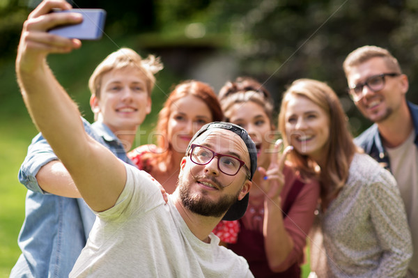 friends taking selfie by smartphone at summer Stock photo © dolgachov