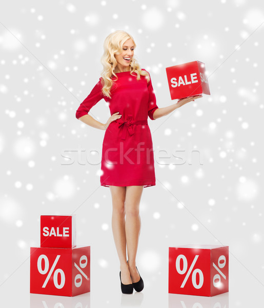 smiling woman with red sale sign over snow Stock photo © dolgachov
