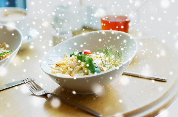close up of pasta in bowl on table at restaurant Stock photo © dolgachov