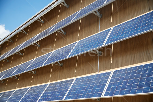 solar battery panels on building facade Stock photo © dolgachov
