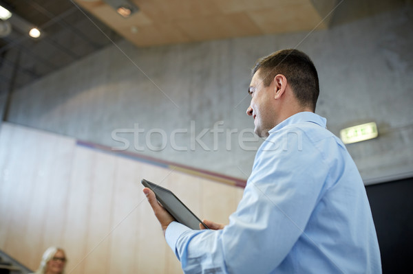 teacher with tablet pc at lecture hall Stock photo © dolgachov