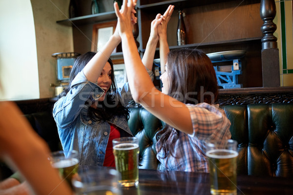 happy friends with beer celebrating at bar or pub Stock photo © dolgachov