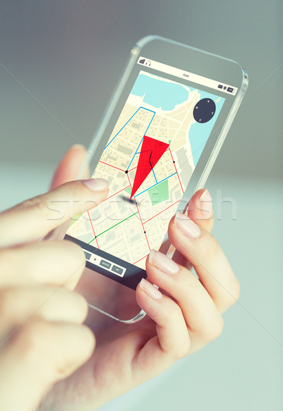 close up of woman with gps navigator on smartphone Stock photo © dolgachov