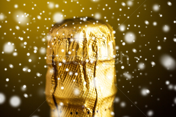 close up of champagne bottle cork wrapped in foil Stock photo © dolgachov