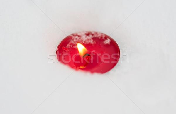 burning christmas candle on snow in winter Stock photo © dolgachov