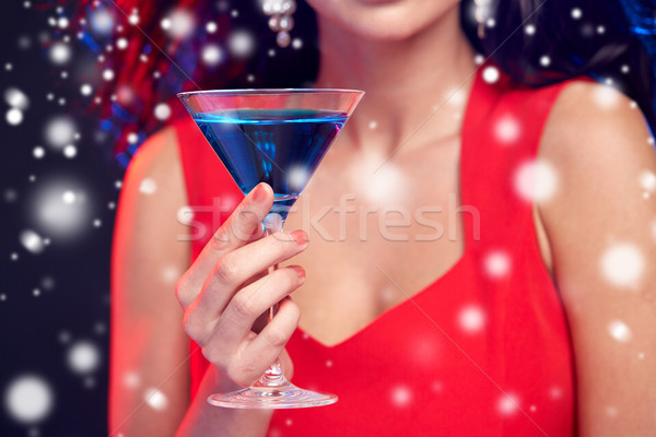 close up of beautiful woman with cocktail at night Stock photo © dolgachov