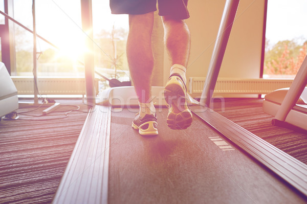 close up of man legs walking on treadmill in gym Stock photo © dolgachov