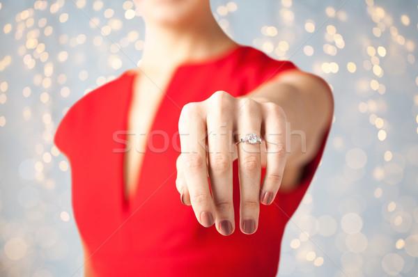 Közelkép nő mutat kéz eljegyzési gyűrű ünnepek Stock fotó © dolgachov