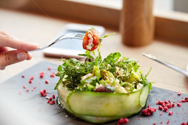 woman eating cottage cheese salad at restaurant Stock photo © dolgachov